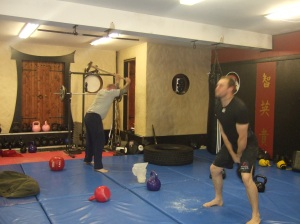 Myself on Swings, Dave G (our Muay Thai Coach) on the hammer